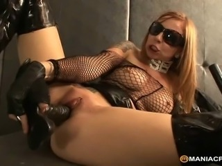 Sexy redhead in black latex using huge dildo on every side satisfy her burning pussy