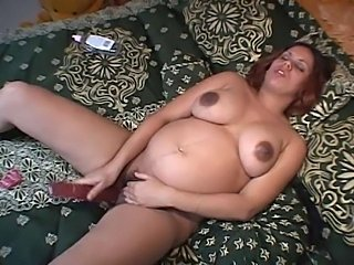 Silver-tongued Latina playing with some huge toys