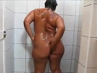 Thick Mature Nudist Goes On touching A Shower