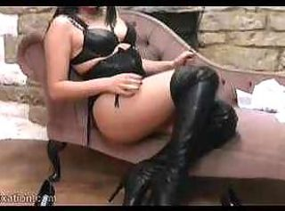Sexy college girl strips down to her leather lingerie and plays wit...