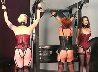 Older bloke tortures his redead brunette and blonde BDSM slaves on rack