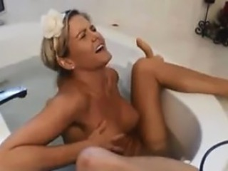 Busty Babe In The Bath Tub With A Dildo