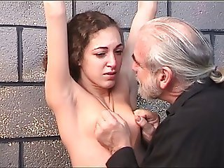 Cute dark haired girl gets restrained and tormented overwrought her older BDSM master