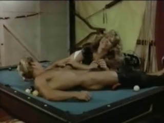 couple test out their new pool table .nice retro couple