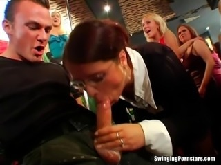 Beauty pornstars giving blowjobs in public in a club