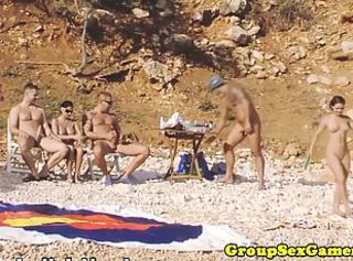 Beach amateur babes connected with group riding cock