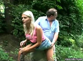 Old dude gets lucky with young blonde in forest.