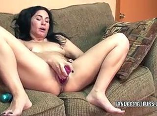 Mature slut Cleo Leroux stuff her twat with a dildo