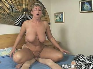 Lucky boy bangs his hot milf mom