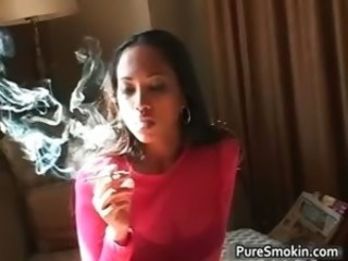 Sexy Negroid hoe lights a cigar part3
