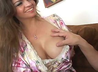 Busty brunette milf getting it