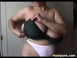 Showing Off Very Large And Saggy Breasts