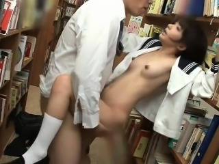Pervert guy fucks cute Japanese schoolgirl in the library