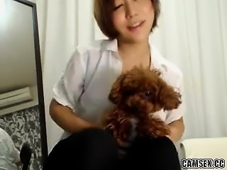 Hot asian babe rubs her tight pussy