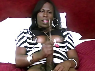 Black shemale babe plays with long cock until cummy orgasm