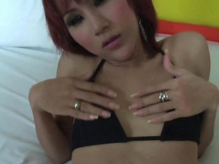 Sexy redhead shemale rubs her boobs