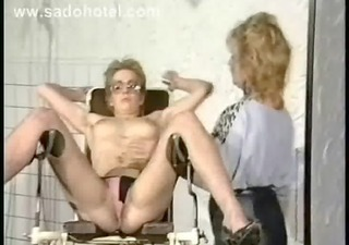 vintage video of slave geting her bumpers coverd in hot candlewax whilst some other bondman acquires