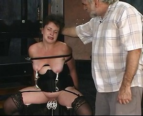 Two old guys torture mature brunette in donjon