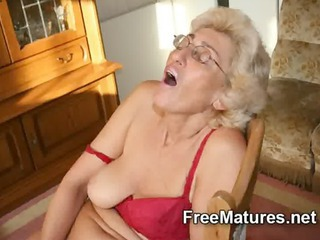 grandmom inside stockings pushing dildo with vibrator