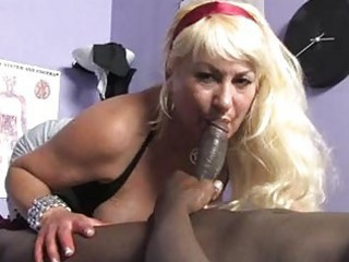 sporty blonde momma with Brobdingnagian titties sucks dark meat pecker