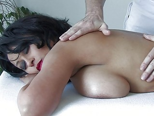 handsome brunette woman with big bosom takes a extremely impressive massage
