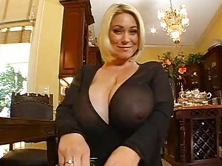 chubby chested blonde momma doing a pov cock sucking