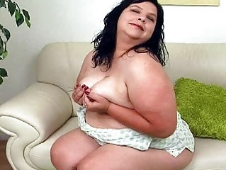 large black haired woman with large bosom sticks sex toy up her nookie