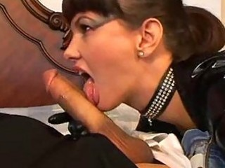 busty lady putting on latex is a cock sucking master