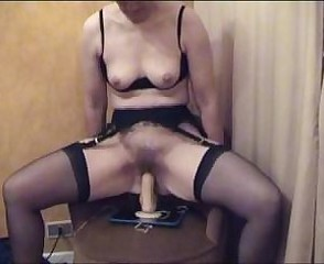 Mature hairy pussy riding a obese dildo on real trail