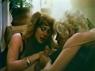two milfs in retro threeway scene