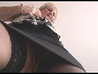 curvy blond aged in taut petticoat and nylons strips