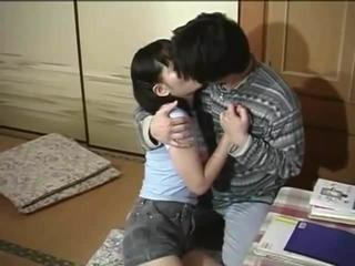 Asian Kissing MILF Strapon