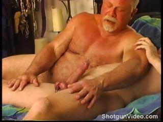 Young hunky dude gets his balls worked over by very experienced top.