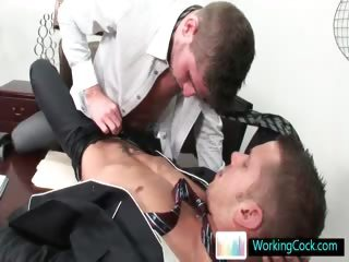 Aroused hunks sucking off and making out at the work part