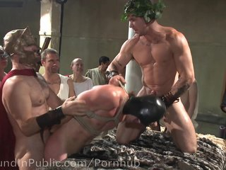 Gladiators Punish Criminal With Brutal Gangbang