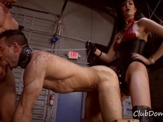 WOMAN FUCKING HER GAY MALE SLAVE WITH A STRAP ON WHILE HE IS SUCKING A COCK