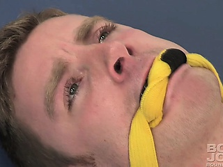 Sebastian Keys fucks a dildo gagged and bound upside down