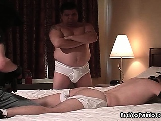 Nasty gay guy gets his fire red as he is spanked hard and