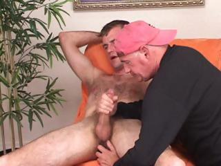 My gay lover wearing a red hat helped me get my dick off by stroking and sucking it