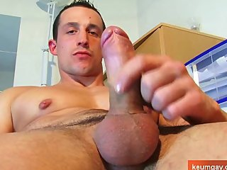 A soccer guy serviced: this straight guy gets wanked his huge cock by a guy