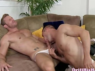 Muscular gay duo sucking dick on sofa