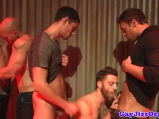 Muscled hunks group blowjob