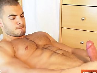 A very sexy arab soccer player gets wanked his enormous cock by a gay guy.