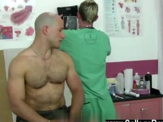 Young gay doctor examines a bald buff