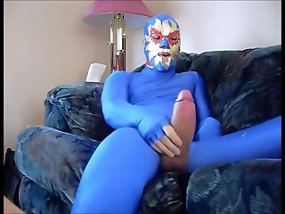 dude in mask a blue zentia suit strokes his big cock