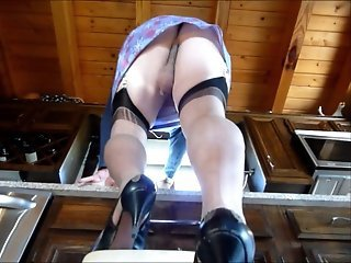 upskirt crossdressing faggot in stockings washes window