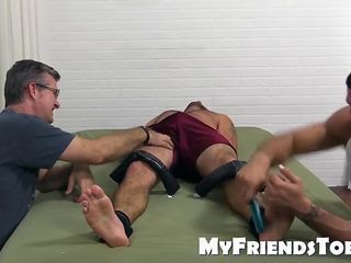 Seth gets a tickle torture from Ricky while being strapped