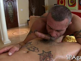 Tattooed stud jacks off his client and bangs him hard