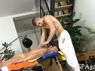 Hunky masseur bangs his client bareback after lots of oil