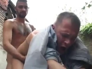 Two gay dudes smoking in an alley end up hooking up, doing deepthroating and anal with BDSM dynamics, humiliation and foot fetish.